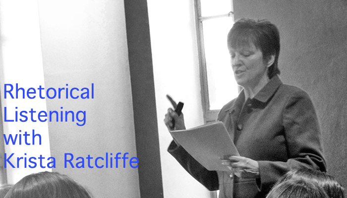 "Black and white image of Ratcliffe standing in front of a crowd, reading from a piece of paper and pointing her finger emphatically. Text reads, ""Rhetorical Listening with Krista Ratcliffe."""